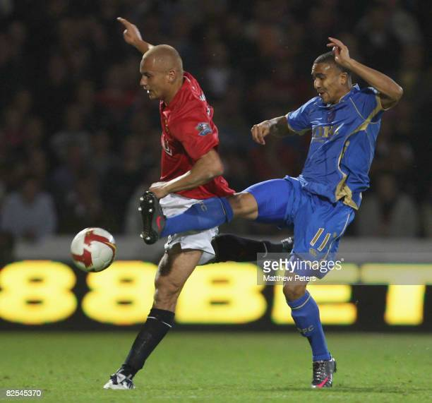 Wes Brown of Manchester United clashes with Jerome Thomas of Portsmouth during the FA Premier League match between Portsmouth and Manchester United...