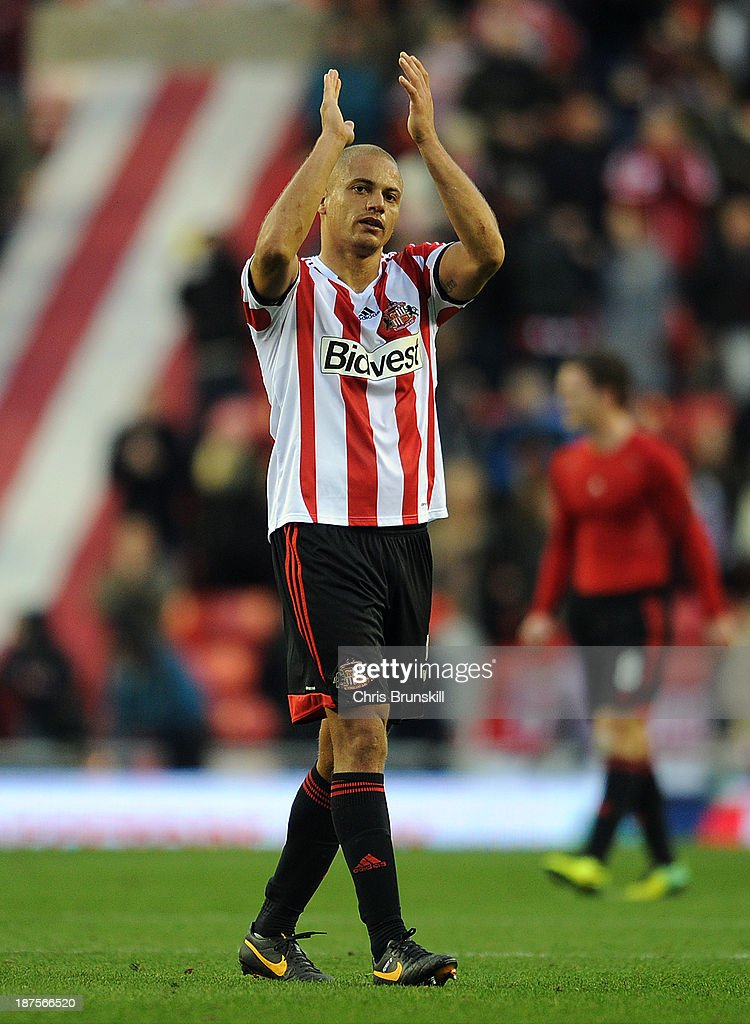 <a gi-track='captionPersonalityLinkClicked' href=/galleries/search?phrase=Wes+Brown+-+Soccer+Player&family=editorial&specificpeople=201876 ng-click='$event.stopPropagation()'>Wes Brown</a> of Sunderland applauds the supporters at full-time during the Barclays Premier League match between Sunderland and Manchester City at Stadium of Light on November 10, 2013 in Sunderland, England.