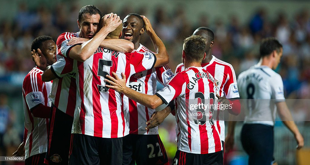 Wes Brown of Sunderland celebrates with teammates after scoring a goal during the Barclays Asia Trophy Semi Final match between Tottenham Hotspur and...