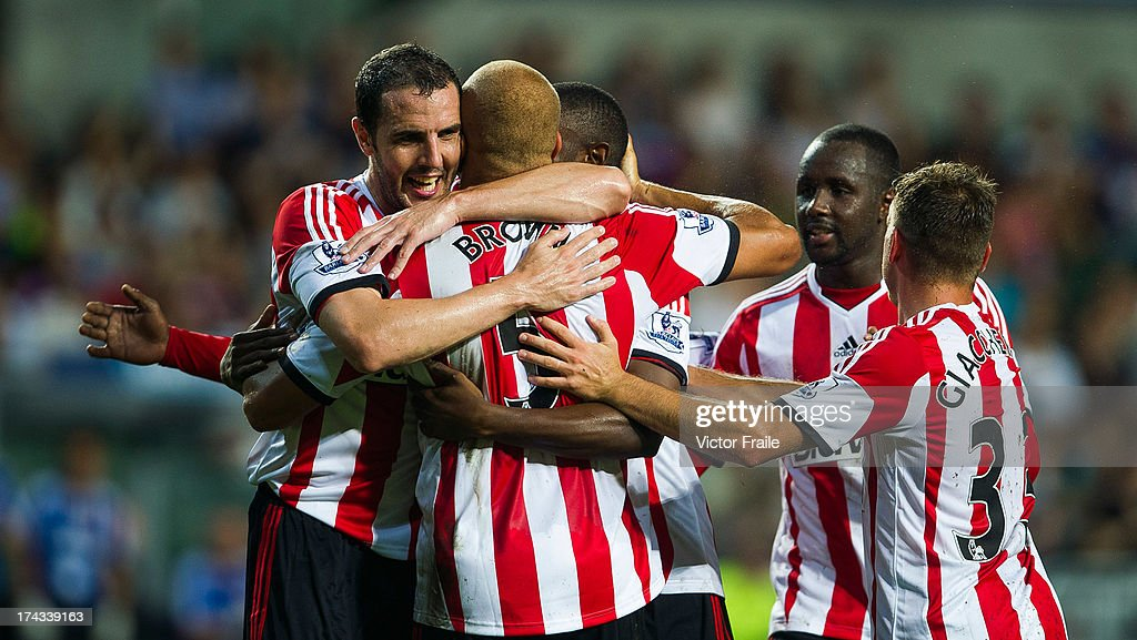 <a gi-track='captionPersonalityLinkClicked' href=/galleries/search?phrase=Wes+Brown+-+Soccer+Player&family=editorial&specificpeople=201876 ng-click='$event.stopPropagation()'>Wes Brown</a> #5 of Sunderland is congratulated byu team-mates after scoring a goal during the Barclays Asia Trophy Semi Final match between Tottenham Hotspur and Sunderland at Hong Kong Stadium on July 24, 2013 in So Kon Po, Hong Kong.