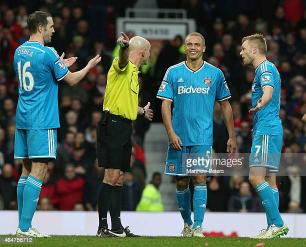 Wes Brown of Sunderland is sent off by Referee Roger East during the Barclays Premier League match between Manchester United and Sunderland at Old...
