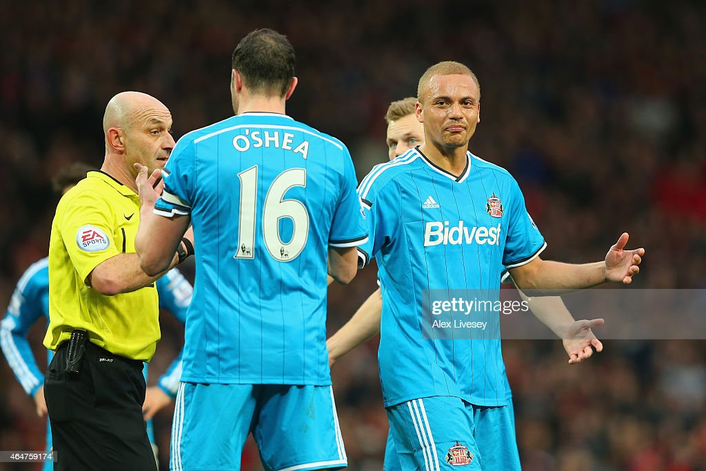 Wes Brown of Sunderland reacts after being shown a straight red card by Refere Roger East for a challenge on Radamel Falcao García of Manchester United during the Barclays Premier League match between Manchester United and Sunderland at Old Trafford on February 28, 2015 in Manchester, England.