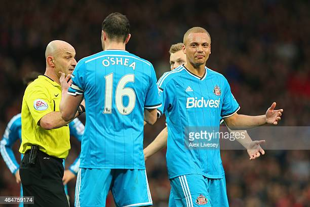 Wes Brown of Sunderland reacts after being shown a straight red card by Refere Roger East for a challenge on Radamel Falcao García of Manchester...