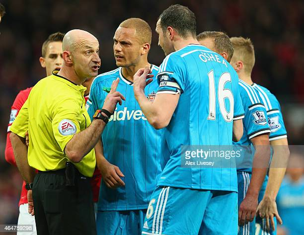 Wes Brown of Sunderland reacts after being shown a straight red card by Refere Roger East as John O'Shea of Sunderland appeals during the Barclays...