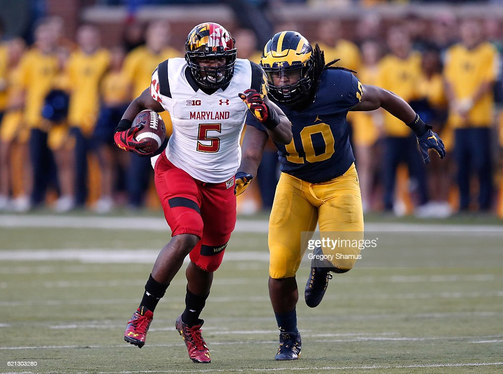 Wes Brown #5 of the Maryland Terrapins tries to outrun Devin Bush #10 of the Michigan Wolverines after a second half catch on November 5, 2016 at Michigan Stadium in Ann Arbor, Michigan. Michigan won the game 59-3.