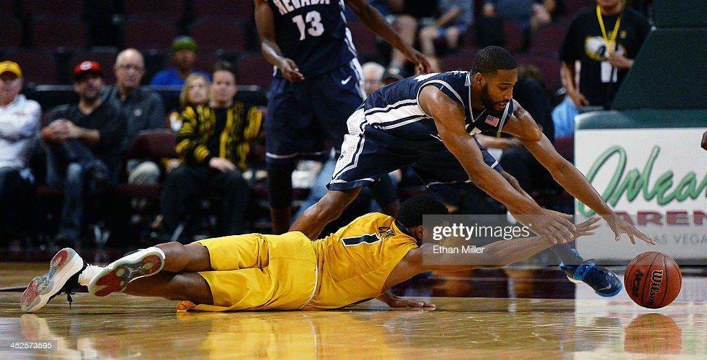 Wes Clark #1 of the Missouri Tigers loses the ball to Deonte Burton #24 of the Nevada Wolf Pack during the Continental Tire Las Vegas Invitational at the Orleans Arena on November 29, 2013 in Las Vegas, Nevada. Missouri won 83-70.