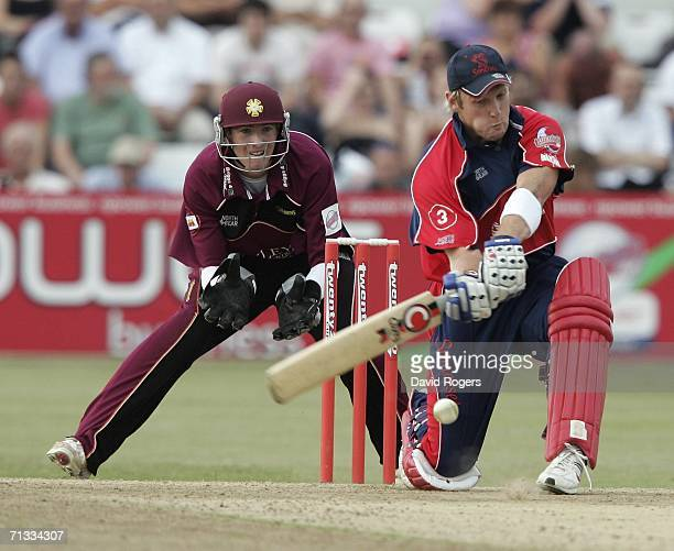 Wes Durston of Somerset cuts the ball as Riki Wessels the Northamptonshire wicket keeper looks on during the Twenty20 match between Northamptonshire...