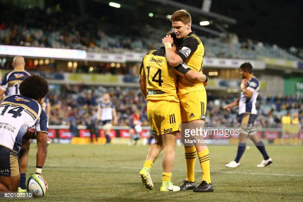 Wes Goosen of the Hurricanes is congratulated by team mate Jordie Barrett after he scored during the Super Rugby Quarter Final match between the...