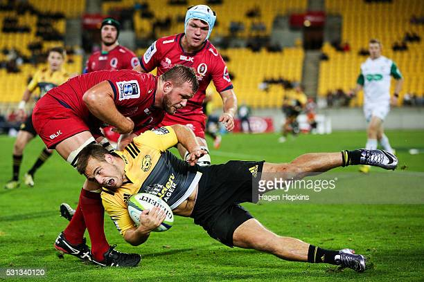 Wes Goosen of the Hurricanes is tackled by Curtis Browning of the Reds during the round 12 Super Rugby match between the Hurricanes and the Reds at...