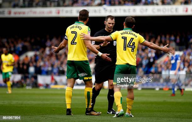 Wes Hoolahan and Ivo Pinto of Norwich City contest a decision by referee Tim Robinson during the Sky Bet Championship match between Ipswich Town and...