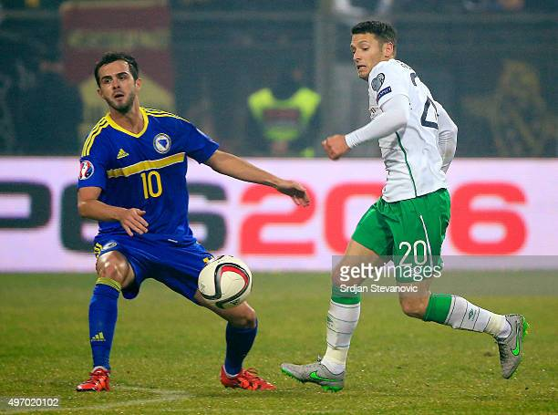 HERZEGOVINA NOVEMBER 13 Wes Hoolahan of Ireland competes for the ball with Miralem Pjanic of Bosnia during the EURO 2016 Qualifier PlayOff First Leg...