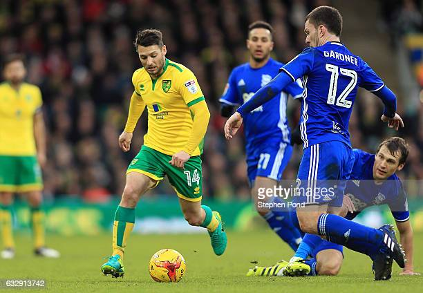Wes Hoolahan of Norwich City and Craig Gardner of Birmingham City compete for the ball during the Sky Bet Championship match between Norwich City and...
