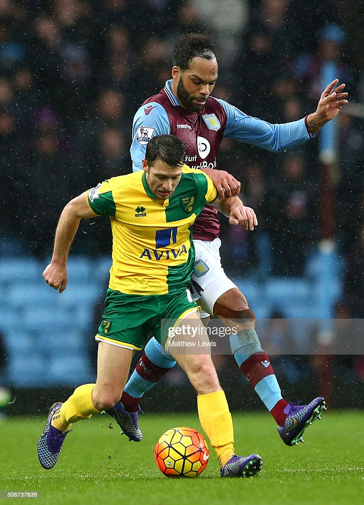 Wes Hoolahan of Norwich City and Joleon Lescott of Aston Villa compete for the ball during the Barclays Premier League match between Aston Villa and Norwich City at Villa Park on February 6, 2016 in Birmingham, England.