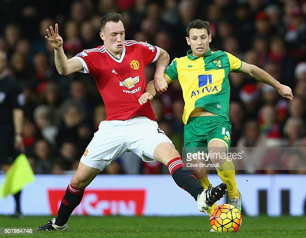 Wes Hoolahan of Norwich City and Phil Jones of Manchester United compete for the ball during the Barclays Premier League match between Manchester...