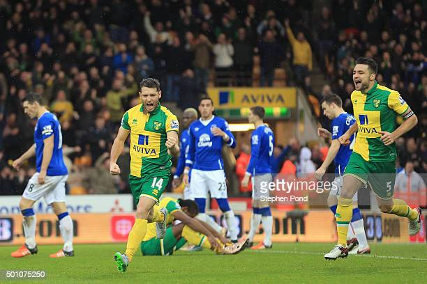 Wes Hoolahan of Norwich City celebrates scoring his team's first goal during the Barclays Premier League match between Norwich City and Everton at...