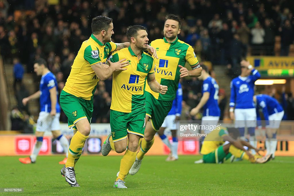 Wes Hoolahan of Norwich City celebrates scoring his team's first goal with his team mates Robbie Brady and Russel Martin during the Barclays Premier...