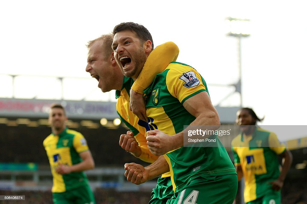 Wes Hoolahan of Norwich City celebrates scoring his team's third goal with his team mate Steven Naismith during the Barclays Premier League match...