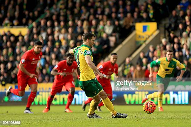 Wes Hoolahan of Norwich City converts the penalty to score his team's third goal during the Barclays Premier League match between Norwich City and...
