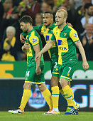 Wes Hoolahan of Norwich City Martin Olsson and Steven Naismith celebrate the own goal scored by Craig Cathcart of Watford during the Barclays Premier...