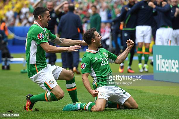 Wes Hoolahan of Republic of Ireland celebrates scoring his team's first goal with his team mate Robbie Brady during the UEFA EURO 2016 Group E match...