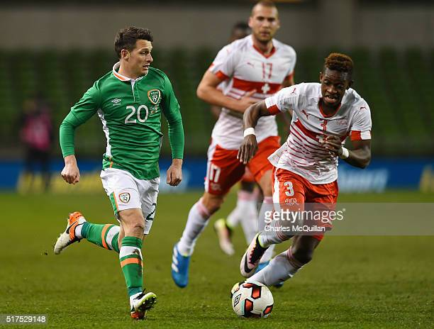 Wes Hoolahan of the Republic of Ireland and JFrancois Moubandje of Switzerland during the international friendly match between the Republic of...
