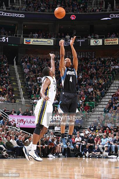 Wes Johnson of the Minnesota Timberwolves shoots the three pointer over CJ Miles of the Utah Jazz at EnergySolutions Arena on January 28 2011 in Salt...