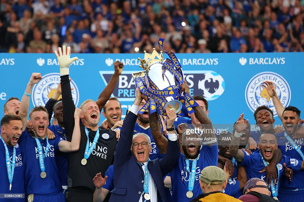 Wes Morgan and Manager/Head Coach of Leicester City Claudio Ranieri lift the Premier League Trophy as Leicester City celebrate becoming Premier...