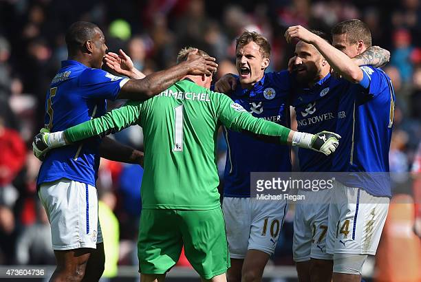 Wes Morgan Kasper Schmeichel Andy King Marcin Wasilewski and Robert Huth of leicester celebrate on the final whistle during the Barclays Premier...