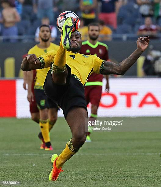 Wes Morgan of Jamaica passes the ball over his head against Venezuela during a match in the 2016 Copa America Centenario at Soldier Field on June 5...