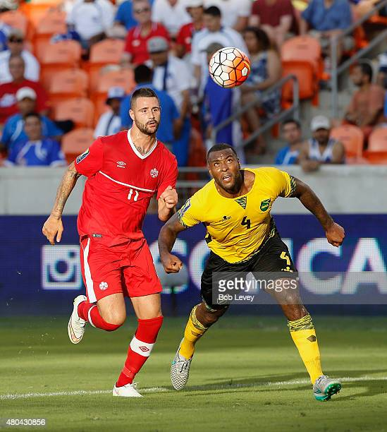 Wes Morgan of Jamaica prepares to head the ball backto his goalkeeper as he is pressured by Marcus Haber of Canada in the second half at BBVA Compass...