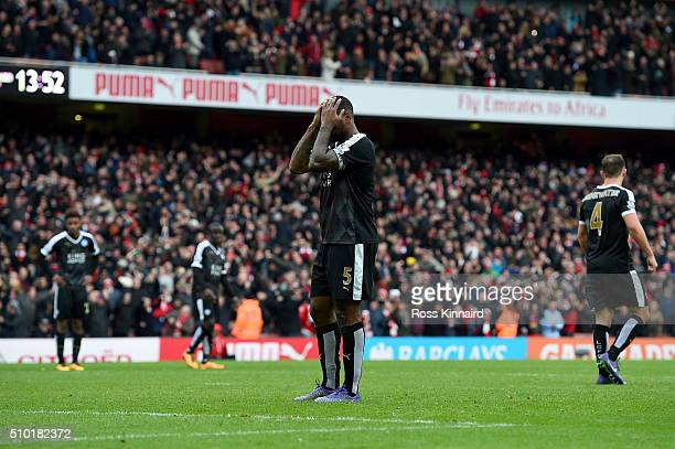 Wes Morgan of Leicester City and his teammates show their dejection after conceding a goal during the Barclays Premier League match between Arsenal...