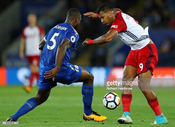 Wes Morgan of Leicester City and Jose Salomon Rondon of West Bromwich Albion during the Premier League match between Leicester City and West Bromwich...
