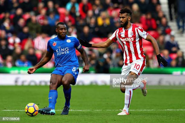 Wes Morgan of Leicester City and Maxim ChoupoMoting of Stoke City in action during the Premier League match between Stoke City and Leicester City at...