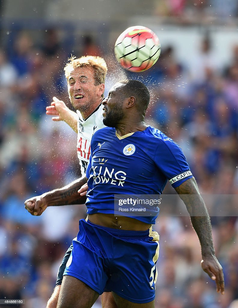 Wes Morgan of Leicester City and Tom Carroll of Tottenham Hotspur compete for the ball during the Barclays Premier League match between Leicester City and Tottenham Hotspur at The King Power Stadium on August 22, 2015 in Leicester, England.