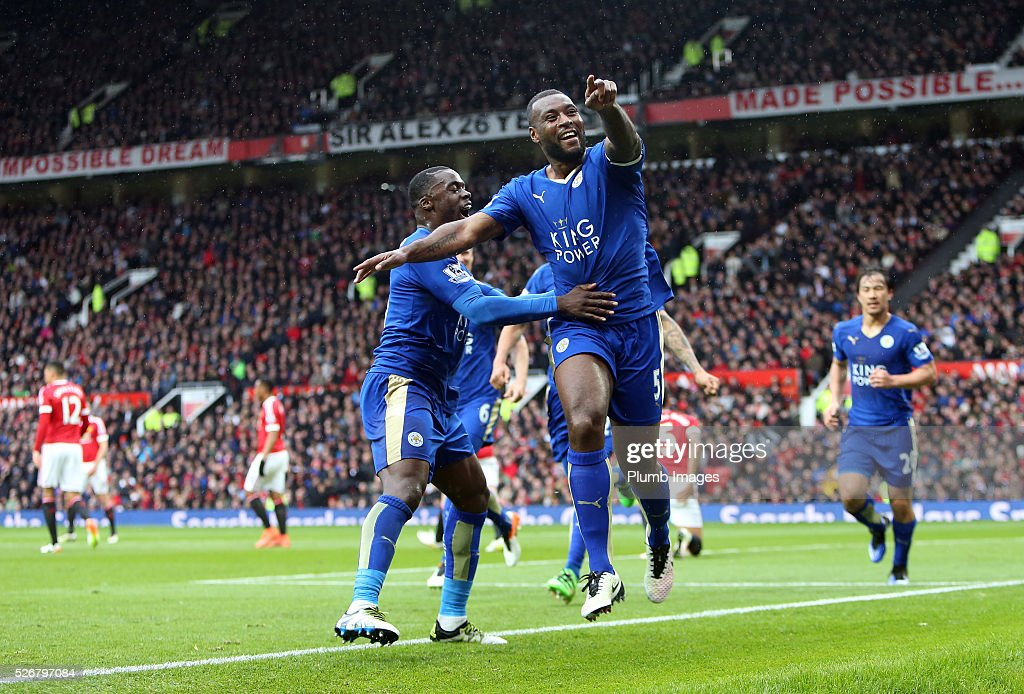 <a gi-track='captionPersonalityLinkClicked' href=/galleries/search?phrase=Wes+Morgan+-+Soccer+Player&family=editorial&specificpeople=13491493 ng-click='$event.stopPropagation()'>Wes Morgan</a> of Leicester City celebrates after scoring to make it 1-1 during the Premier League match between Manchester United and Leicester City at Old Trafford on May 01, 2016 in Manchester, United Kingdom.