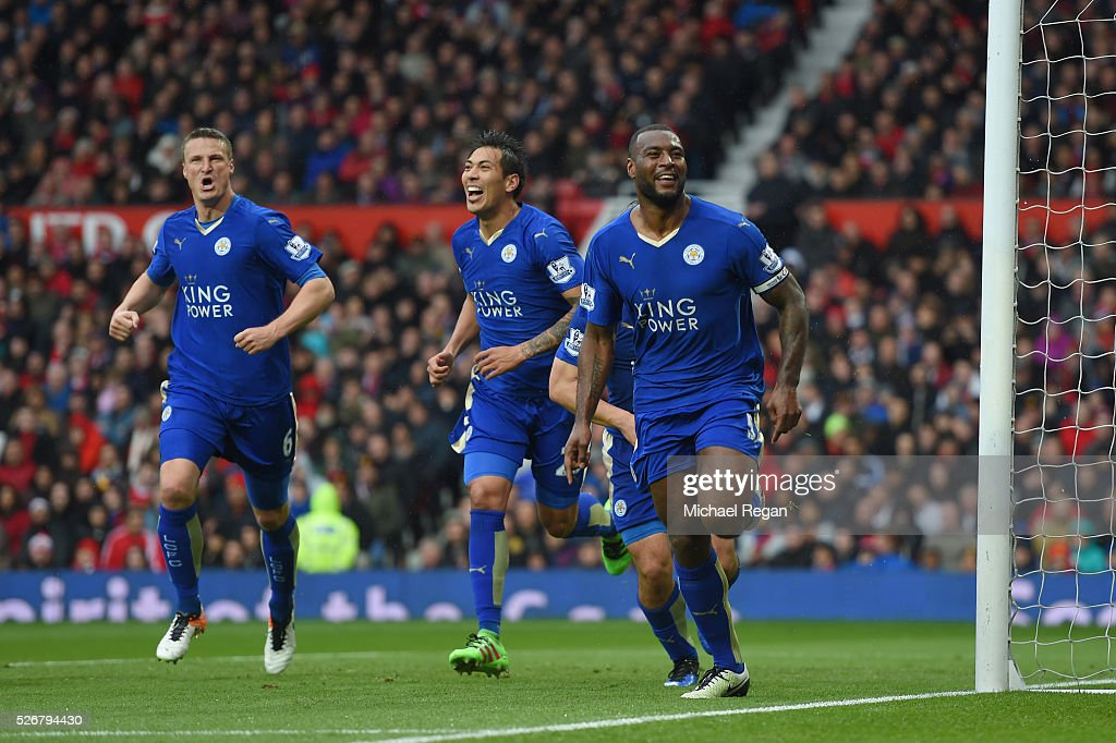 <a gi-track='captionPersonalityLinkClicked' href=/galleries/search?phrase=Wes+Morgan+-+Soccer+Player&family=editorial&specificpeople=13491493 ng-click='$event.stopPropagation()'>Wes Morgan</a> (R) of Leicester City celebrates scoring his team's opening goal with team mates during the Barclays Premier League match between Manchester United and Leicester City at Old Trafford on May 1, 2016 in Manchester, England.
