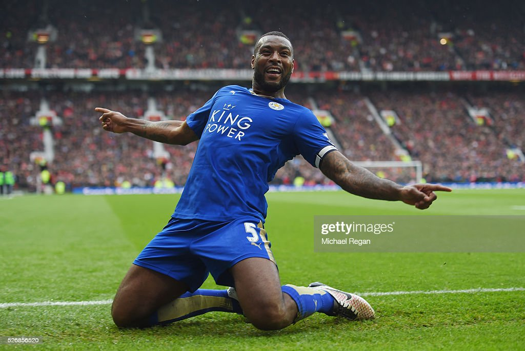 Wes Morgan of Leicester City celebrates scoring his team's opening goal during the Barclays Premier League match between Manchester United and Leicester City at Old Trafford on May 1, 2016 in Manchester, England.