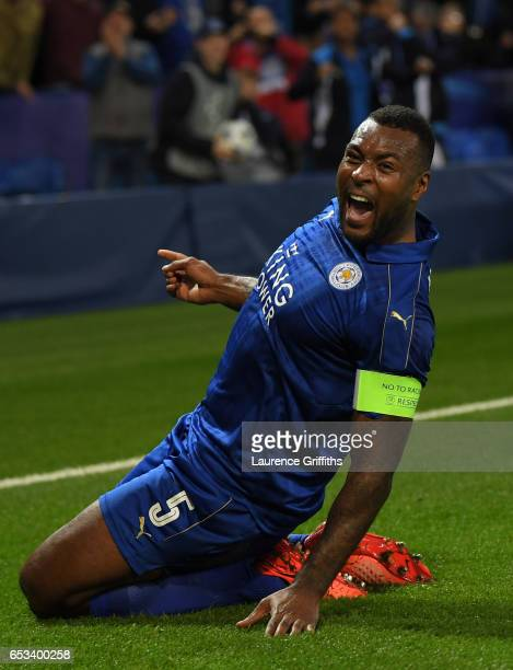 Wes Morgan of Leicester City celebrates scoring the opening goal during the UEFA Champions League Round of 16 second leg match between Leicester City...