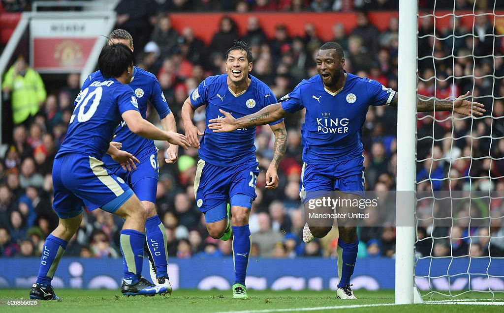 Wes Morgan of Leicester City celebrates scoring their first goal during the Barclays Premier League match between Manchester United and Leicester City at Old Trafford on May 1, 2016 in Manchester, England.