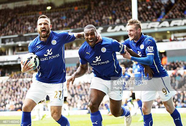 Wes Morgan of Leicester City celebrates with Jamie Vardy and Marcin Wasileski also of Leicester to make it 22 during the Premier League match between...