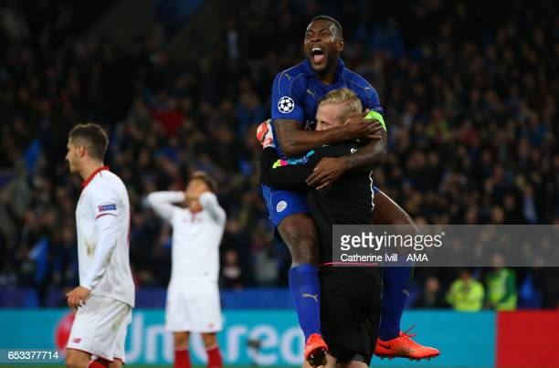 Wes Morgan of Leicester City celebrates with Leicester City goalkeeper Kasper Schmeichel after he saves a penalty during the UEFA Champions League...