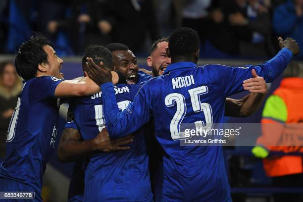 Wes Morgan of Leicester City celebrates with teammates after scoring the opening goal during the UEFA Champions League Round of 16 second leg match...