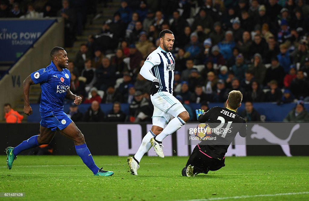 Wes Morgan of Leicester City closes down Matt Phillips of West Bromwich Albion as he chips Ron-Robert Zieler of Leicester City to score his sides second goal during the Premier League match between Leicester City and West Bromwich Albion at The King Power Stadium on November 6, 2016 in Leicester, England.