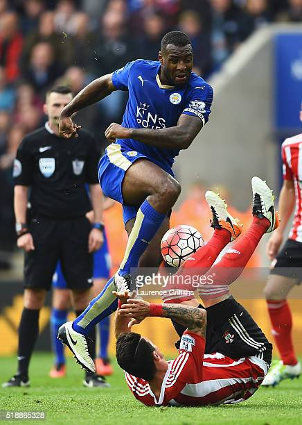 Wes Morgan of Leicester City is blocked by Jose Fonte of Southampton during the Barclays Premier League match between Leicester City and Southampton...