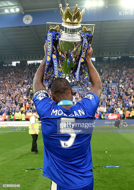 Wes Morgan of Leicester City lifts the Premier League Trophy as players and staffs celebrate the season champion after the Barclays Premier League...