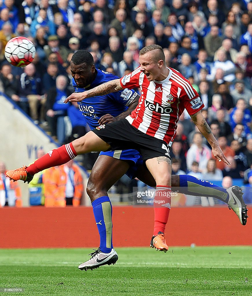 Wes Morgan of Leicester City outjumps Jordy Clasie of Southampton to score their first goal during the Barclays Premier League match between Leicester City and Southampton at The King Power Stadium on April 3, 2016 in Leicester, England.