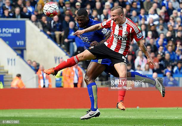 Wes Morgan of Leicester City outjumps Jordy Clasie of Southampton to score their first goal during the Barclays Premier League match between...