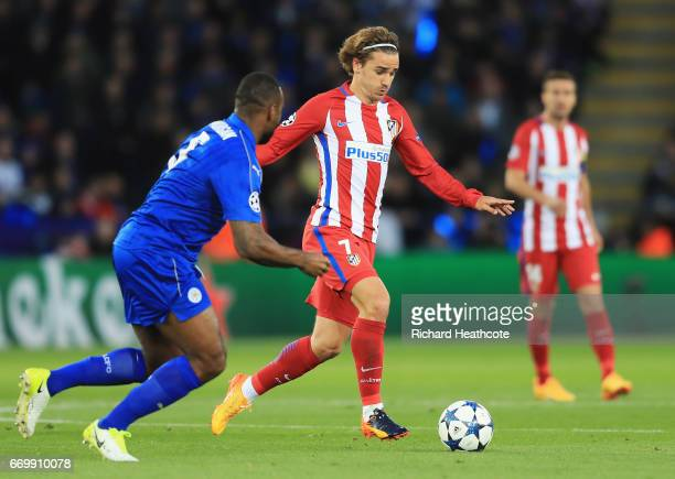 Wes Morgan of Leicester City puts pressure on Antoine Griezmann of Atletico Madrid during the UEFA Champions League Quarter Final second leg match...