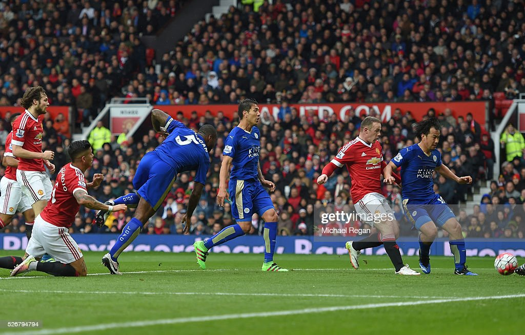 <a gi-track='captionPersonalityLinkClicked' href=/galleries/search?phrase=Wes+Morgan+-+Soccer+Player&family=editorial&specificpeople=13491493 ng-click='$event.stopPropagation()'>Wes Morgan</a> of Leicester City scores his team's opening goal during the Barclays Premier League match between Manchester United and Leicester City at Old Trafford on May 1, 2016 in Manchester, England.