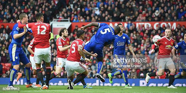 Wes Morgan of Leicester City scores their first goal during the Barclays Premier League match between Manchester United and Leicester City at Old...